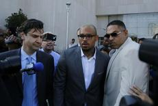 Singer Chris Brown (C) departs D.C. Superior Court in Washington September 2, 2014.  REUTERS/Gary Cameron