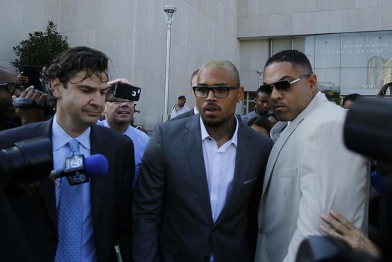Singer Chris Brown (C) departs D.C. Superior Court in Washington September 2, 2014. REUTERS-Gary Cameron