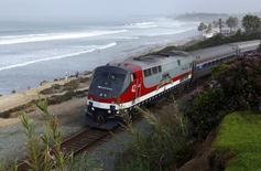 An Amtrak passenger train makes it way along the coastline as it passes through Del Mar, California March 17, 2014. REUTERS/Mike Blake