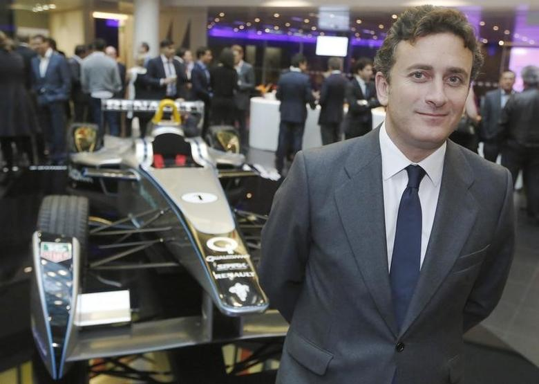 Alejandro Agag, CEO of Formula E Holdings, poses for a photograph with the Formula E car on display in London November 12, 2013.   REUTERS/Luke MacGregor