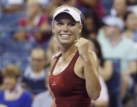 Caroline Wozniacki of Denmark celebrates defeating Sara Errani of Italy in their women's quarter-finals singles match at the 2014 U.S. Open tennis tournament in New York, September 2, 2014. REUTERS/Shannon Stapleton