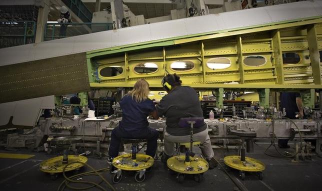 A pair of workers assemble a wing for the Boeing 777 at the company's plant in Everett, Washington, October 18, 2012. REUTERS/Andy Clark