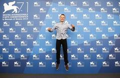 "Cast member Romain Paul poses during the photo call for the movie ""Le dernier coup de marteau"" at the 71st Venice Film Festival September 3, 2014. REUTERS/Tony Gentile"
