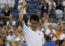 Kei Nishikori of Japan celebrates after defeating Stan Wawrinka of Switzerland in their quarter-final match at the 2014 U.S. Open tennis tournament in New York, September 3, 2014. REUTERS/Mike Segar