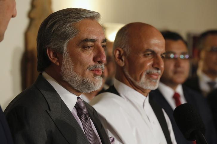 Afghanistan's presidential candidate Abdullah Abdullah (L) addresses a news conference with rival Ashraf Ghani (R) at this side as they announced a deal for the auditing of all Afghan election votes at the United Nations Compound in Kabul, late July 12, 2014. REUTERS/Jim Bourg