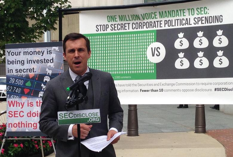 Columbia Law Professor Robert Jackson addresses a news conference in front of the U.S. Securities and Exchange Commission headquarters in Washington, September 4, 2014.  REUTERS/Sarah N. Lynch