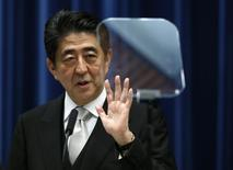 Japan's Prime Minister Shinzo Abe speaks next to a teleprompter during a news conference after reshuffling his cabinet, at his official residence in Tokyo September 3, 2014. REUTERS/Yuya Shino