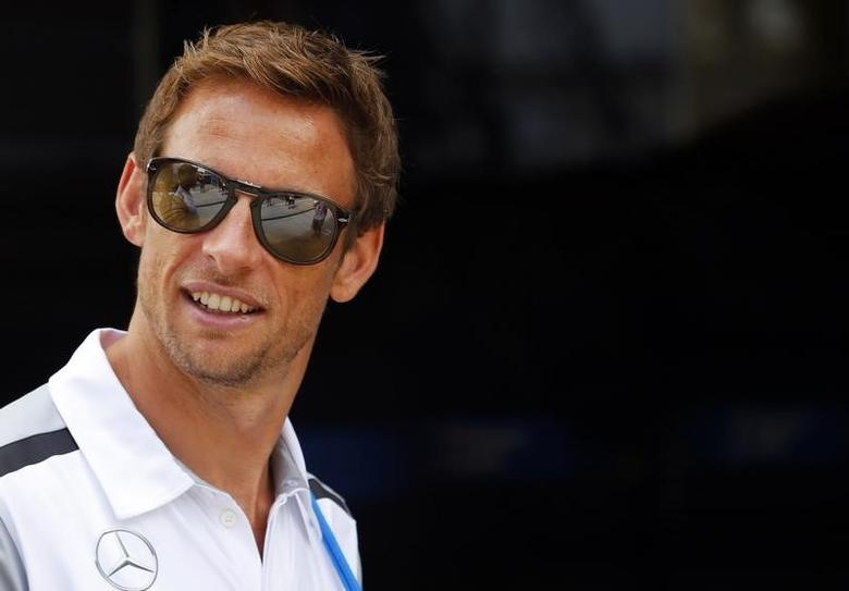 McLaren Formula One driver Jenson Button of Britain arrives at theC circuit, near Budapest, July 24, 2014. REUTERS/Laszlo Balogh