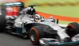 Mercedes Formula One driver Lewis Hamilton of Britain drives on the track during the first practice session of the Italian F1 Grand Prix in Monza September 5, 2014. REUTERS/Stefano Rellandini