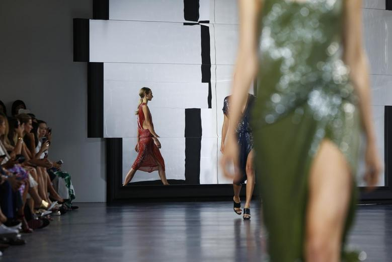 Models present creations from the Jason Wu Spring/Summer 2015 collection during New York Fashion Week September 5, 2014. REUTERS/Lucas Jackson