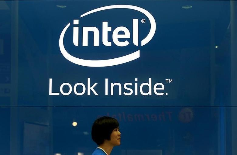 An employee walks past an Intel logo during the 2014 Computex exhibition at the TWTC Nangang exhibition hall in Taipei June 3, 2014. Computex, the world's second largest computer show, runs from June 3 to 7.  REUTERS/Pichi Chuang