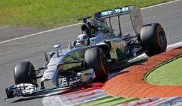 Mercedes Formula One driver Lewis Hamilton of Britain takes a curve during the third practice session of the Italian F1 Grand Prix in Monza September 6, 2014.  REUTERS/Max Rossi