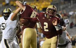 Boston College Eagles quarterback Tyler Murphy (2) is tackled by Pittsburgh Panthers defensive back Ray Vinopal (9) during the second half at Alumni Stadium.  Pitt won 30-20 over Boston College. Gregory J. Fisher-USA TODAY Sports