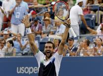 Marin Cilic of Croatia celebrates after defeating Roger Federer of Switzerland in their semi-final match at the 2014 U.S. Open tennis tournament in New York, September 6, 2014.        REUTERS/Ray Stubblebine