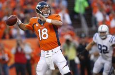 Sep 7, 2014; Denver, CO, USA; Denver Broncos quarterback Peyton Manning (18) throws a pass during the first half against the against the Indianapolis Colts  at Sports Authority Field at Mile High. Chris Humphreys-USA TODAY Sports