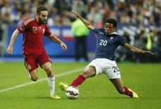 France's Loic Remy (R) challenges Spain's Daniel Carvajal during their international friendly soccer match at the Stade de France stadium in Saint-Denis, near Paris, September 4, 2014.  REUTERS/Benoit Tessier