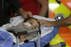 Ashya King, a 5-year-old British boy with a brain tumour, lies on a stretcher as he arrives with his parents at Motol hospital in in Prague  September 8, 2014.    REUTERS/David W Cerny