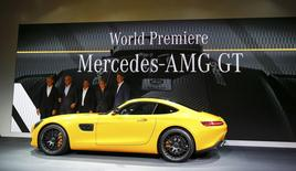 Thomas Weber, Member of the Board of Management of Daimler AG, Daimler CEO Dieter Zetsche, Tobias Moers, CEO of Mercedes-AMG, Mercedes Formula One driver Nico Rosberg and Mercedes sales head Ola Kaellenius (L-R) pose at the world premiere of the new Mercedes AMG GT super sports car at the Mercedes AMG headquarters in Affalterbach near Stuttgart, September 9, 2014.           REUTERS/Kai Pfaffenbach (GERMANY  - Tags: TRANSPORT SPORT MOTORSPORT BUSINESS)