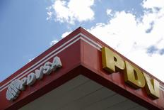 The logo of Venezuela's oil company PDVSA is seen at its gas station in Caracas August 29, 2014. Venezuela's state-run PDVSA has put on hold its plans to export diluted crude oil (DCO) in October as the company reviews production costs that have risen on imports of costly naphtha that it uses to mix with its extra heavy crude, traders told Reuters on Friday. REUTERS/Carlos Garcia Rawlins (VENEZUELA - Tags: ENERGY POLITICS BUSINESS LOGO)