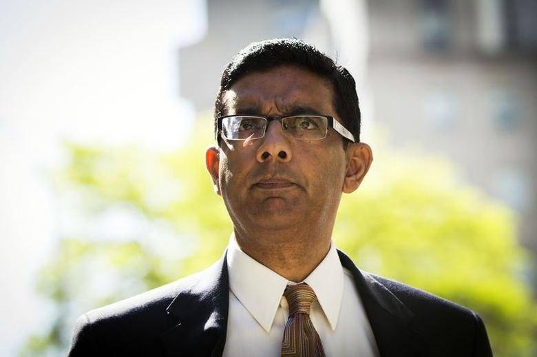 Conservative commentator and best-selling author, Dinesh D'Souza exits the Manhattan Federal Courthouse after pleading guilty in New York in this file photo taken May 20, 2014. REUTERS/Lucas Jackson/Files
