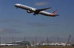 An American Airlines airplane takes off from Heathrow airport in London July 3, 2014. REUTERS/Luke MacGregor