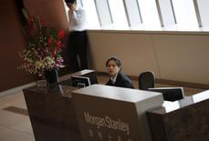 A receptionist sits at a Morgan Stanley office which was visited by Chinese investigators in Shanghai, September 4, 2014. Picture taken September 4, 2014. REUTERS/Carlos Barria