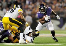 Sep 11, 2014; Baltimore, MD, USA; Baltimore Ravens running back Justin Forsett (29) runs past Pittsburgh Steelers linebacker Jason Worilds (93) at M&T Bank Stadium. Mandatory Credit: Evan Habeeb-USA TODAY Sports