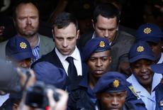 South African Olympic and Paralympic sprinter Oscar Pistorius leaves the North Gauteng High Court in Pretoria, September 12, 2014.  REUTERS/Mike Hutchings