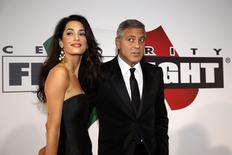 Director and actor George Clooney arrives with his fiancee barrister Amal Alamuddin to attend the Celebrity Fight Night event in Florence September 7, 2014. REUTERS/Giampiero Sposito