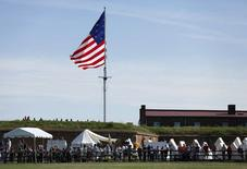 "A huge U.S. flag flies over visitors to Fort McHenry as they try to get a glimpse of U.S. President Barack Obama during his visit to the historic spot where Francis Scott Key was inspired to write ""The Star Spangled Banner"" in Baltimore, Maryland September 12, 2014. REUTERS/Kevin Lamarque"
