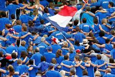 French supporters cheer their team during Gael Monfils' victory over Czech Republic's Lukas Rosol in their semi-final Davis Cup match at Roland Garros Stadium in Paris September 14, 2014. REUTERS/Charles Platiau