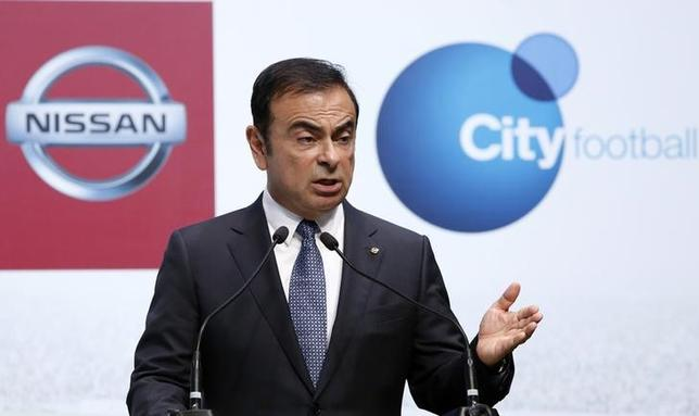 Nissan Motor Co's President and Chief Executive Officer Carlos Ghosn speaks next to Manchester City Football Club Chief Executive Officer Ferran Soriano (not in picture) during a joint news conference in Yokohama, south of Tokyo July 17, 2014. REUTERS/Yuya Shino