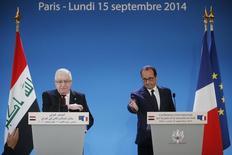 Presidente francês, François Hollande, e presidente do Iraque, Fuad Masum, na abertura de conferência sobre o Iraque em Paris. 15/09/2014 REUTERS/Christian Hartmann