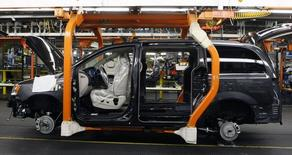 A partially assembled Chrysler minivan works its way down the assembly line during the production launch of the new 2011 Dodge Grand Caravan's and Chrysler Town & Country minivans at the Windsor Assembly Plant in Windsor, Ontario January 18, 2011. REUTERS/Rebecca Cook