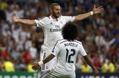 Benzema e Marcelo comemoram gol do Real Madrid contra o Basel.  REUTERS/Sergio Perez