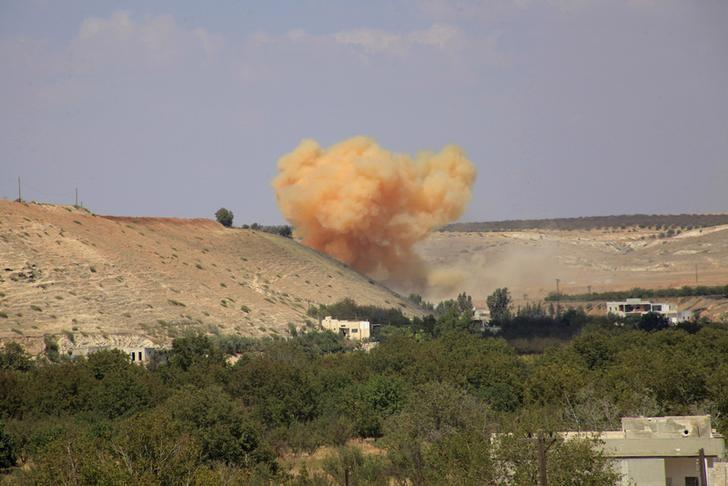 Smoke rises at a site where forces loyal to Syria's President Bashar al-Assad said they have struck, on the outskirts of Zur Abu-Zeid village in the northern Hama countryside, after saying they have regained control of the village, September 14, 2014.   REUTERS/George Ourfalian