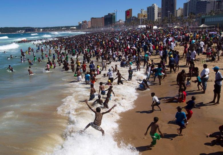 People visit the beach on New Year's Day in Durban in this January 1, 2014 file photo.    REUTERS/Rogan Ward/Files