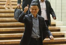 Alibaba founder Jack Ma gives a thumbs-up as he arrives to speak to investors at an initial public offering roadshow in Singapore September 16, 2014. REUTERS/Edgar Su