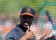 Mar 10, 2014; Scottsdale, AZ, USA; San Francisco Giants former outfielder Barry Bonds reacts during batting practice prior to the game against the Chicago Cubs at Scottsdale Stadium. Mandatory Credit: Mark J. Rebilas-USA TODAY Sports