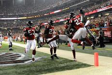 Sep 18, 2014; Atlanta, GA, USA; Atlanta Falcons wide receiver Devin Hester (17) (with ball) reacts with teammates after returning a punt for a touchdown against the Tampa Bay Buccaneers during the first half at the Georgia Dome. Mandatory Credit: Dale Zanine-USA TODAY Sports