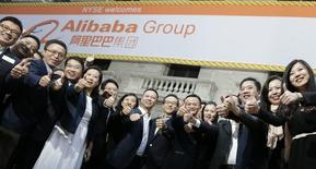 "Alibaba Group Holding Ltd founder Jack Ma (2nd L) poses as he arrives at the New York Stock Exchange for his company's initial public offering (IPO) under the ticker ""BABA"" in New York September 19, 2014. REUTERS/Brendan McDermid"
