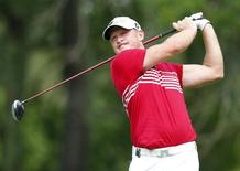 Jamie Donaldson of Wales hits a driver off the second tee during the final round of the 2014 PGA Championship at Valhalla Golf Club in Louisville, Kentucky, August 10, 2014. REUTERS/John Sommers II