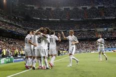 Jogadores do Real Madrid comemoram gol marcado contra o Basel na Liga dos Campeões. 16/09/2014 REUTERS/Juan Medina