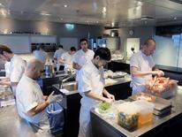 Chef Esben Holmboe Bang (R) works in the kitchen of his restaurant Maaemo in Oslo, September 9, 2014. REUTERS/Gwladys Fouche