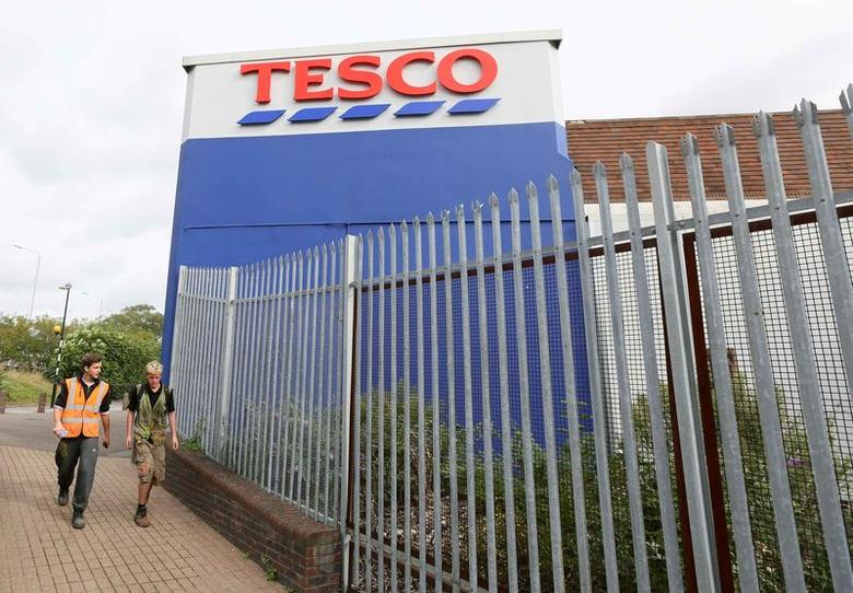 Pedestrians walk past a Tesco store in Bow, east London August 29, 2014. REUTERS/Paul Hackett