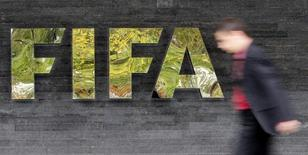 A man walks past a logo next to the main entrance of the Home of FIFA in Zurich October 20, 2010.  REUTERS/Christian Hartmann
