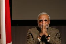 India's Prime Minister Narendra Modi gestures after giving a speech at his lecture meeting hosted by Nikkei Inc. and Japan External Trade Organization (JETRO) in Tokyo September 2, 2014.    REUTERS/Toru Hanai/Files
