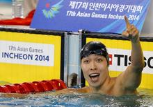 Japan's Kosuke Hagino reacts after winning in the men's 200m freestyle final swimming competition at the Munhak Park Tae-hwan Aquatics Center during the 17th Asian Games in Incheon September 21, 2014. REUTERS/Tim Wimborne