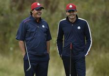 U.S. Ryder Cup player Phil Mickelson (L) speaks with teammate Keegan Bradley on the 15th green during practice ahead of the 2014 Ryder Cup at Gleneagles in Scotland September 23, 2014. REUTERS/Toby Melville