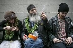 Hu Barney (C), smokes a joint during 420Fest at the Luxe Nightclub in Seattle, Washington April 20, 2013. In November 2012, voters approved legalizing the recreational use of marijuana in the state of Washington for adults over 21. REUTERS/Nick Adams